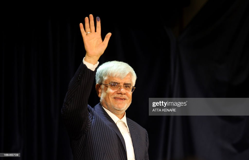 Iranian former Vice-President Mohammad Reza Aref waves after he registered his candidacy for the upcoming presidential election at the interior ministry in Tehran on May 10, 2013. Iran began a five-day registration period for candidates in Iran's June 14 presidential election, with a string of conservative hopefuls in the running but with key reformists yet to come forward, media reports said. AFP PHOTO/ATTA KENARE