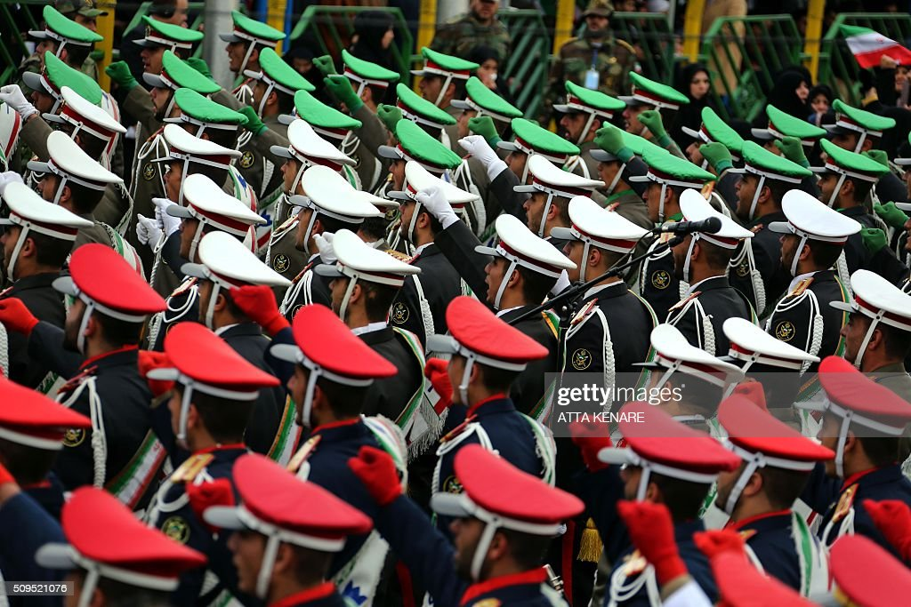 Iranian guards march during celebrations in Tehran's Azadi Square (Freedom Square) to mark the 37th anniversary of the Islamic revolution on February 11, 2016. Iranians waved 'Death to America' banners and took selfies with a ballistic missile as they marked 37 years since the Islamic revolution, weeks after Iran finalised a nuclear deal with world powers. KENARE