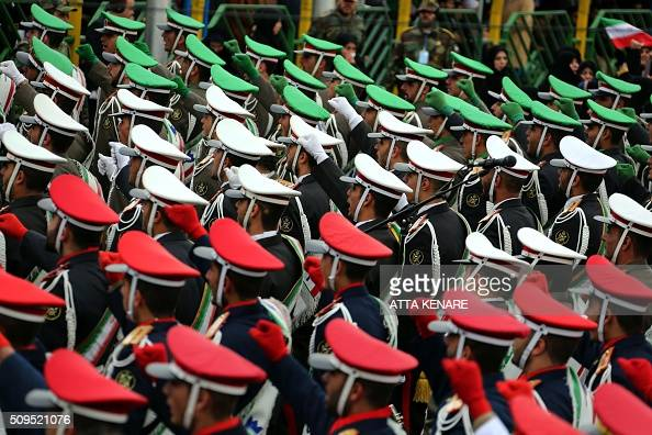 Iranian guards march during celebrations in Tehran's Azadi Square to mark the 37th anniversary of the Islamic revolution on February 11 2016 Iranians...