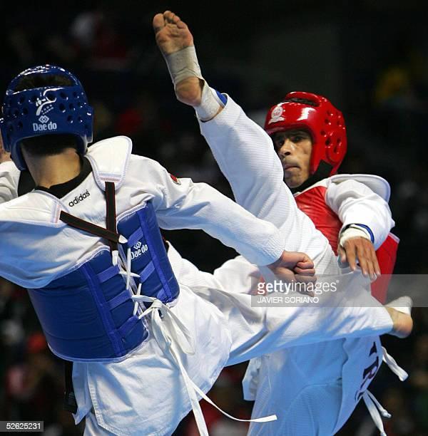 Iranian Hadi Saei Bonehkohal fights against Russian Alan Akoev during their women's under 72 kg finals match at the Taekwondo World Championships in...
