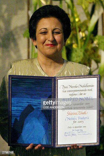 Iranian human rights activist and Nobel laureate Shirin Ebadi poses with the Nobel Peace prize diploma during a ceremony in Oslo's city hall 10...