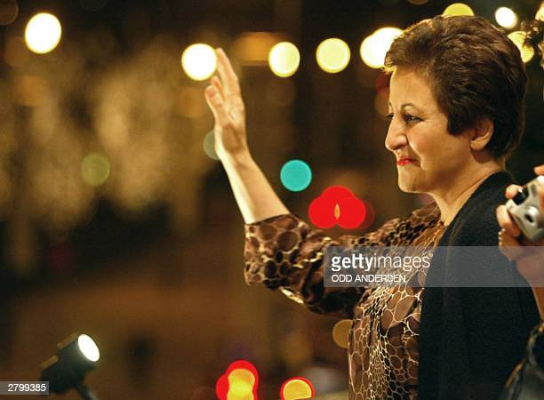 Iranian human rights activist and Nobel laureate Shirin Ebadi waves to wellwishers from her hotel balcony in Oslo 10 December 2003 The committee...