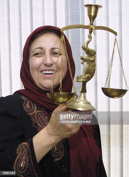 Iranian human rights activist feminist lawyer and Nobel Peace Prize winner Shirin Ebadi poses for photographers in her office after a press...
