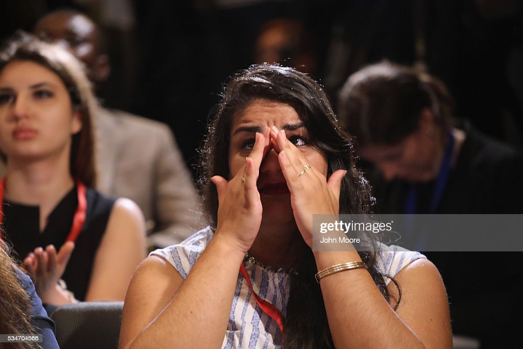 Iranian immigrant Sara Dinari wipes away tears of joy after becoming an American citizen at a naturalization ceremony on Ellis Island on May 27, 2016 in New York City. U.S. Secretary of Homeland Security Jeh Johnson administered the oath of citizenship to immigrants from 39 countries on the historic island in New York Harbor where millions of immigrants first arrived to America. The ceremony, held by U.S. Citizenship and Immigration Services (USCIS), was held in honor of Memorial Day and is one of 100 naturalization ceremonies held in U.S. national parks in celebration of the National Park Service's 100th anniversary.