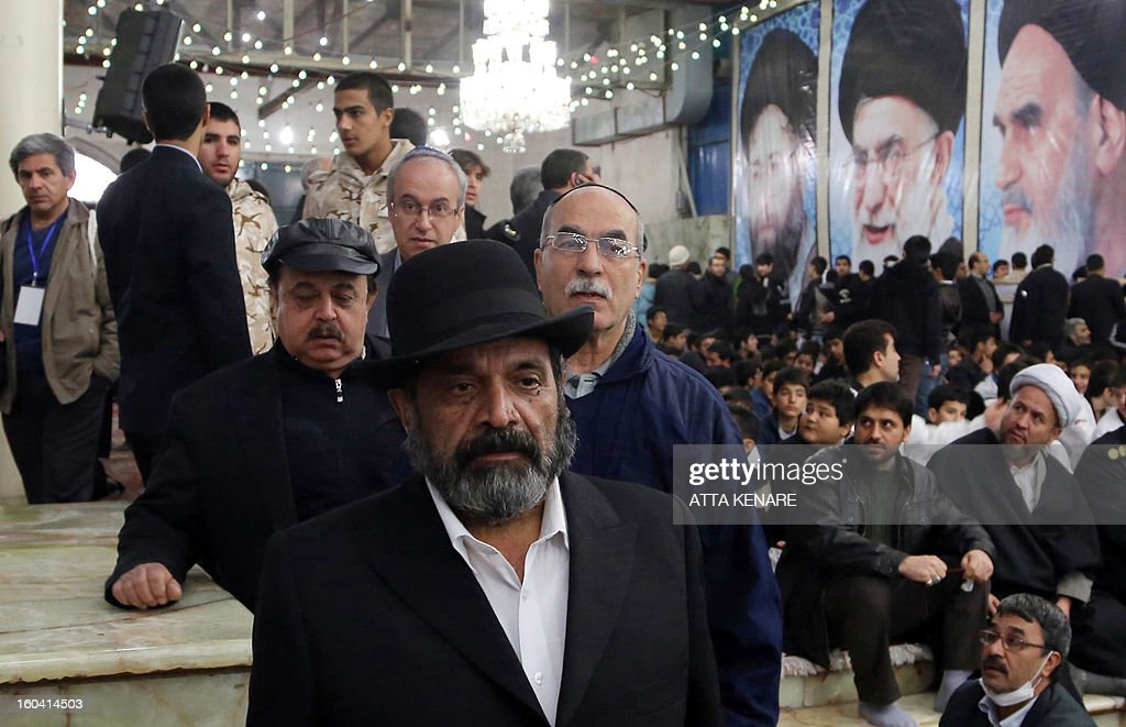 Iranian Jewish priests take part in a ceremony marking the 34th anniversary of the return from exile of the founder of Iran's Islamic Republic, Ayatollah Ruhollah Khomeini on January 31, 2013 at Khomeini's mausoleum in Tehran. Bells chimed across Iran to mark his return from exile in 1979, the trigger for a revolution which spawned an Islamic state now engulfed in a deep political crisis.