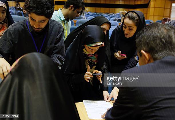 Iranian journalists work in a press room at the Interior Ministry as they follow the preliminary results of the parliamentary and Experts Assembly...