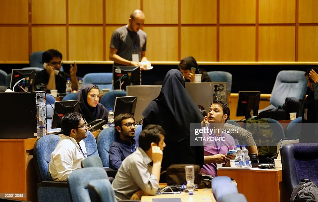 Iranian journalists work in a press room at the interior ministry in the capital Tehran on April 30, 2016 as they follow the preliminary results of the country's second round parliamentary elections. Reformist and moderate politicians allied with Iran's President Hassan Rouhani won most seats in second round parliamentary elections, local media reported. Unofficial and incomplete results said that of the 68 seats being contested at least 33 had gone to the pro-Rouhani List of Hope, with conservatives gaining 21 more MPs. KENARE