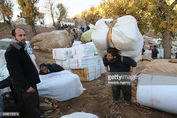 Iranian Kurdish border smugglers prepare goods mostly consisting of electronic devices and white goods either to load onto trucks or to carry on...