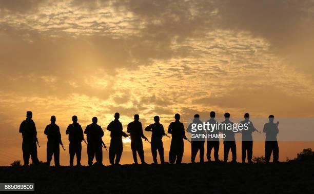 TOPSHOT Iranian Kurdish Peshmerga members of the Iranian Kurdistan Democratic Party take part in routine military exercise in Koya 100 kms east of...