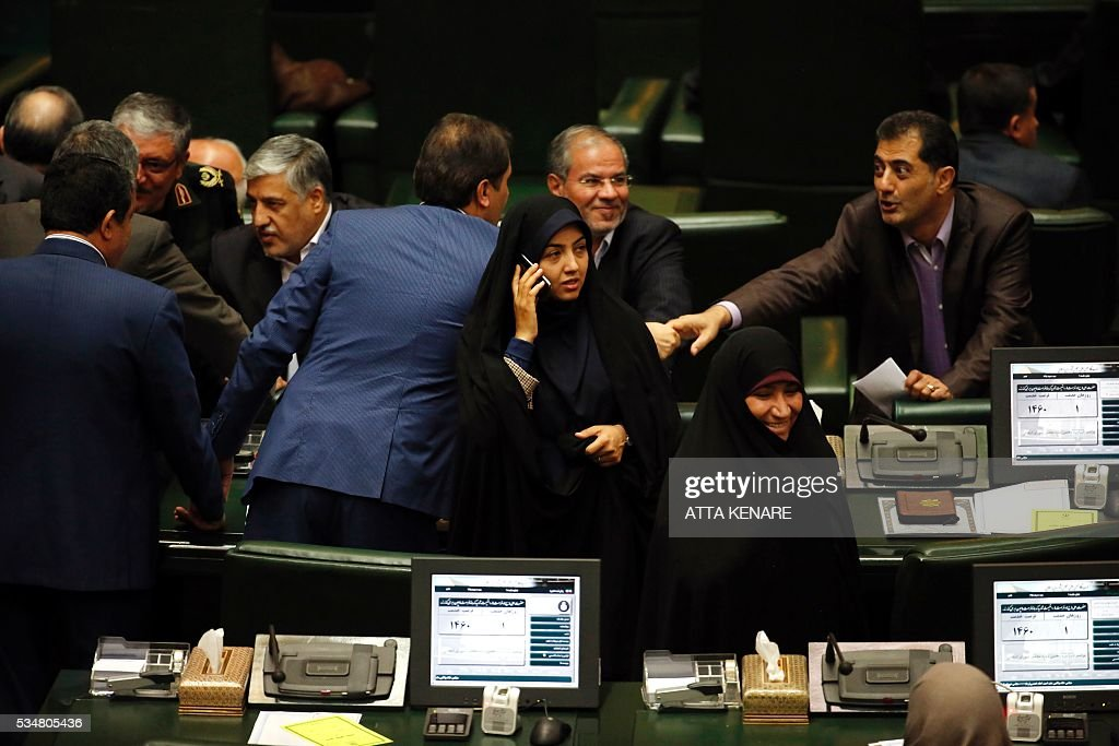 Iranian lawmakers chat during the opening session of the new parliament in Tehran on May 28, 2016. Iranian parliamentarians met for the first time since elections finished in April. KENARE
