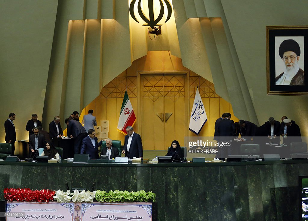 Iranian lawmakers count the ballots for the new Parliament speaker, during a parliament session in Tehran on May 29, 2016. Moderate conservative Ali Larijani retained the speakership of Iran's parliament despite major gains for reformists in February elections, benefiting from credit gained by his support for last year's nuclear deal. / AFP / ATTA