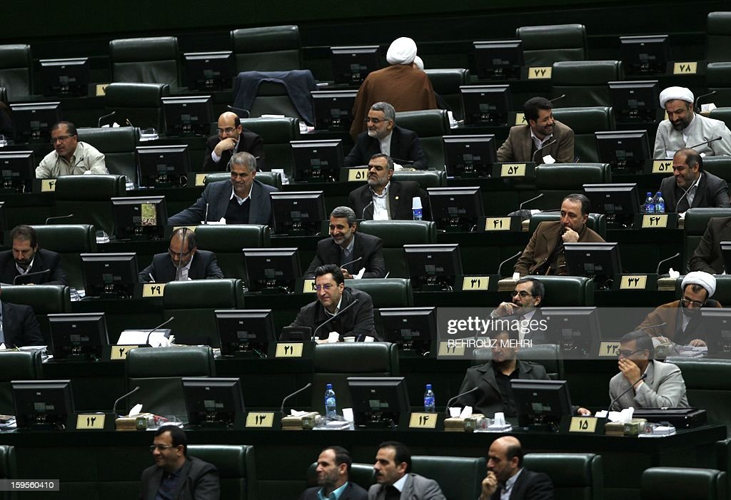Iranian lawmakers listen to the speech of President Mahmoud Ahmadinejad on the county's economic situation in Tehran on January 16, 2013. Experts from the International Atomic Energy Agency (IAEA) arrived in Tehran to try resolve long-running differences with Iran over its controversial nuclear programme.