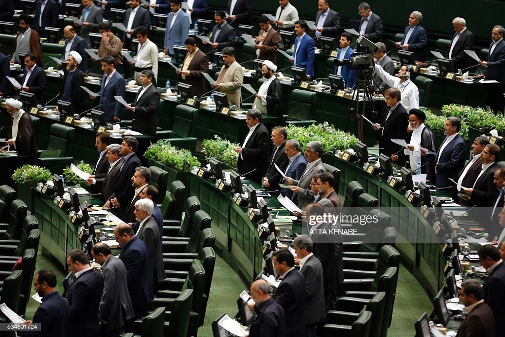 Iranian lawmakers take their oath during the opening session of the new parliament in Tehran on May 28, 2016. Iranian parliamentarians met in Tehran for the first time since elections finished in April. KENARE