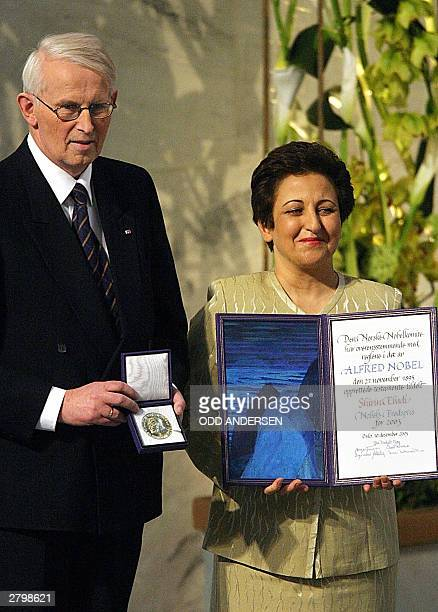 Iranian lawyer and human rights activist Shirin Ebadi and Nobel Committee chairman Ole Danbolt Mjoes poses with the medal and diploma after Ebadi was...