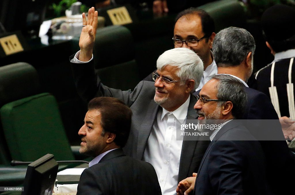 Iranian reformist Mohammad Reza Aref (C) gestures as he attends the opening session of the new parliament in Tehran on May 28, 2016. / AFP / ATTA