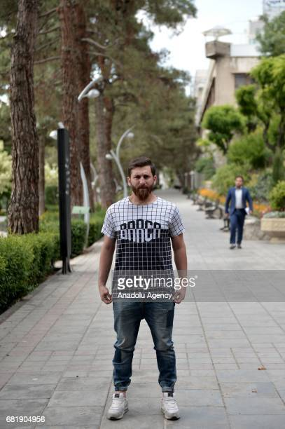 Iranian Lionel Messi lookalike university student Reza Parastesh poses for a photo in Tehran Iran on May 11 2017 Reza grew a beard similar to Lionel...