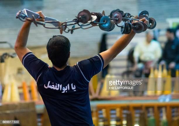 Iranian man training with kabbadeh chain and bow at Saheb A Zaman Club Zurkhaneh on October 23 2015 in Yazd Iran