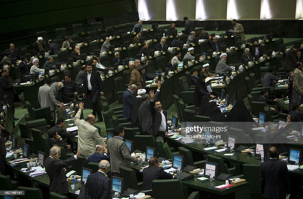 Iranian Members of Parliament attend a parliament session to discuss the annual budget bill which is being presented by the government in Tehran on February 27, 2013. Iran and world powers agreed to hold new talks in March and April over Iran's disputed nuclear drive, with Tehran hailing a 'more realistic' approach by their counterparts at two days of talks in Kazakhstan.