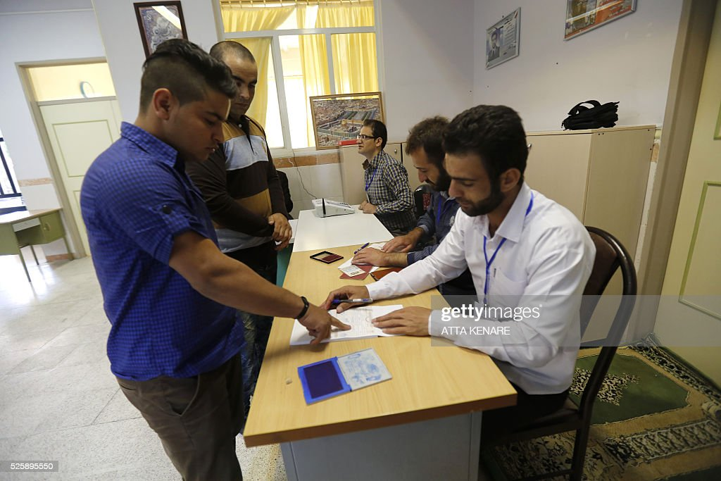 Iranian men arrive to cast their vote in the second round of parliamentary elections at a polling station in the town of Robat Karim, some 40 kms southwest of the capital Tehran, on April 29, 2016. Iranians started voting in second round elections for almost a quarter of parliament's seats, the latest political showdown between reformists and conservatives seeking to influence the country's future. Polling stations opened at 8:00 am (0330 GMT) for the ballot which is taking place in 21 provinces, but not Tehran, because no candidate in 68 constituencies managed to win 25 percent of votes cast in initial voting on February 26. Reformists who backed moderate President Hassan Rouhani made big gains in the first round following Iran's implementation of a nuclear deal with world powers, which lifted sanctions blamed for long hobbling the economy. Conservative MPs, including vehement opponents of the West who openly criticised the landmark agreement that reined in Iran's atomic programme, lost dozens of seats and were wiped out in Tehran where reformists won all 30 places in parliament. / AFP / ATTA