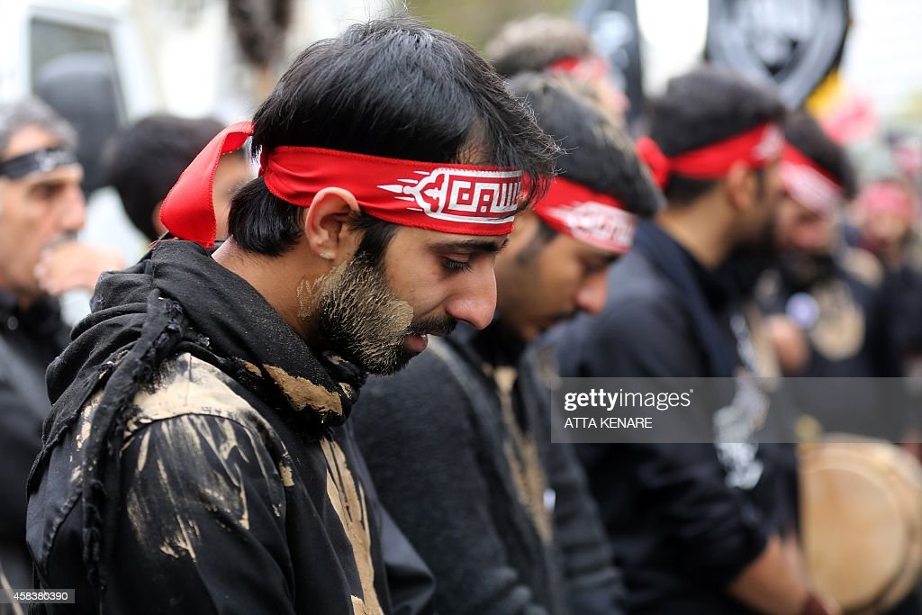 Iranian men cry during the Ashura commemorations that mark the killing of Imam Hussein one of Shiite Islam's most revered figures on November 4 in...