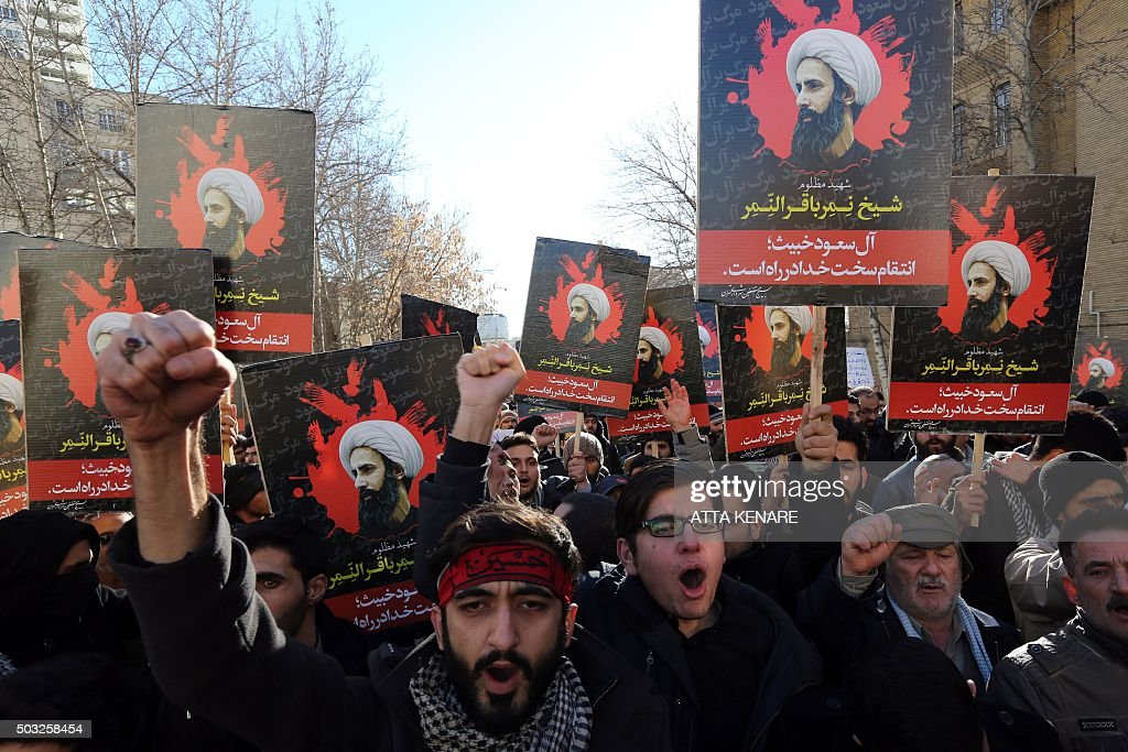 Iranian men hold portraits of prominent Shiite Muslim cleric Nimr alNimr during a demonstration against his execution by Saudi authorities on January...