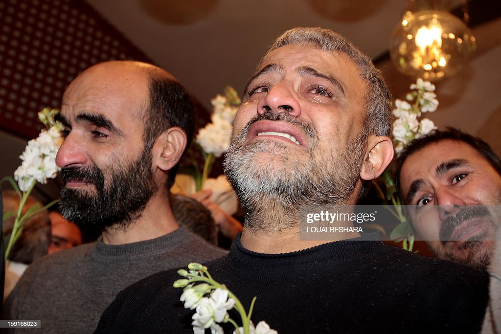 Iranian men who had been held hostage by Syrian rebels since early August cry as they arrive at a hotel in Damascus after being freed in a prisoner swap on January 9, 2013. A total of 48 Iranians were released in the unprecedented exchange for 2,130 prisoners detained by President Bashar al-Assad's regime, according to several sources.