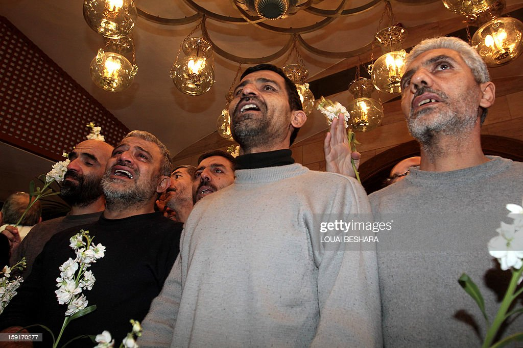 Iranian men who had been held hostage by Syrian rebels since early August arrive at a hotel in Damascus after being freed in a prisoner swap on January 9, 2013. A total of 48 Iranians were released in the unprecedented exchange for 2,130 prisoners detained by President Bashar al-Assad's regime, according to several sources. AFP PHOTO/LOUAI BESHARA