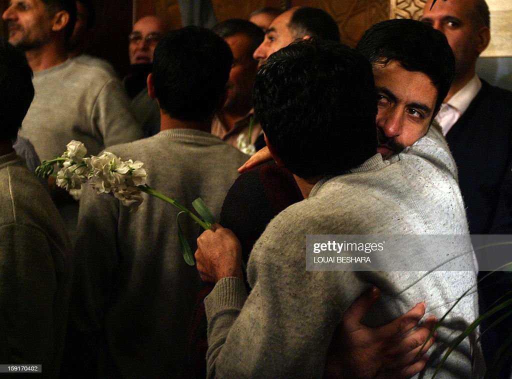 Iranian men who had been held hostage by Syrian rebels since early August hug each other as they arrive at a hotel in Damascus after being freed in a prisoner swap on January 9, 2013. A total of 48 Iranians were released in the unprecedented exchange for 2,130 prisoners detained by President Bashar al-Assad's regime, according to several sources. AFP PHOTO/LOUAI BESHARA
