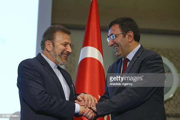 Iranian Minister of Communication Mahmoud Vaezi and Turkish Development Minister Cevdet Yilmaz are seen during signing ceremony of IranTurkey Joint...