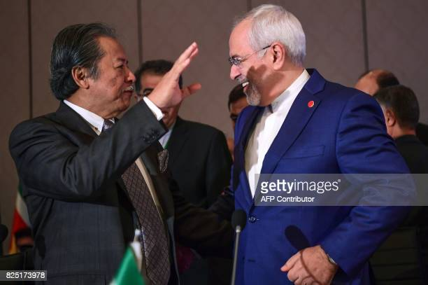 Iranian Minister of Foreign Affairs Mohammad Javad Zarif and Malaysian foreign minister Dato Sri Anifah Aman gesture as they attend the Executive...