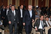 Iranian Minister of Foreign affairs Mohammad Javad Zarif and Hoshyar Zebari the Iraqi Minister of Foreign Affairs walk to give a press conference at...