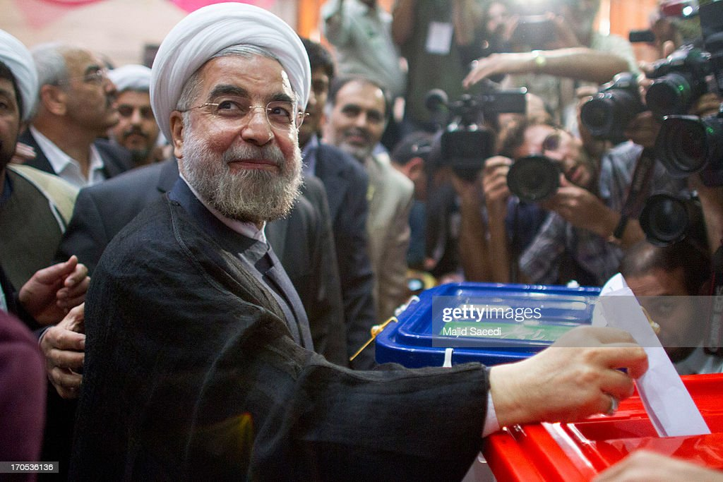 Iranian moderate presidential candidate, Hassan Rowhani casts his vote at a polling station during the first round of the presidential election on June 14, 2013 in Tehran, Iran. Four years after the disputed re-election of Mahmoud Ahmadinejad, Iranians are voting to choose a new president in an election which reformists are hopeful that their sole candidate will win in the face of divided conservative ranks.