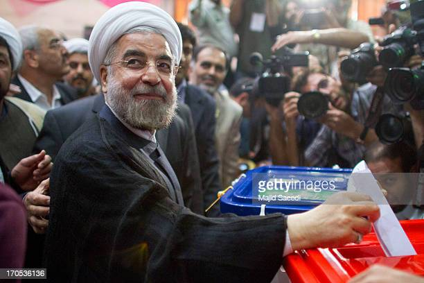 Iranian moderate presidential candidate Hassan Rowhani casts his vote at a polling station during the first round of the presidential election on...