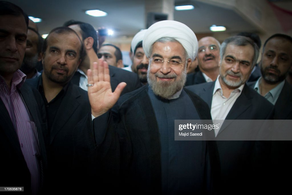 Iranian moderate presidential candidate, Hassan Rowhani waves as he leaves a polling station after voting in the first round of the presidential election on June 14, 2013 in Tehran, Iran. Four years after the disputed re-election of Mahmoud Ahmadinejad, Iranians are voting to choose a new president in an election which reformists are hopeful that their sole candidate will win in the face of divided conservative ranks.