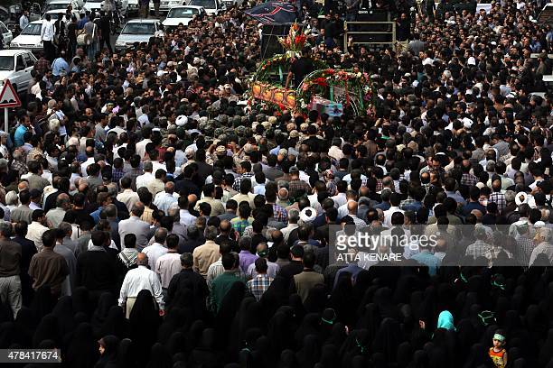 Iranian mourners attend the funeral of Mohammad Hamidi Hasan Ghafari and Ali Amrai all three members of the Islamic Republic's Revolutionary Guards...