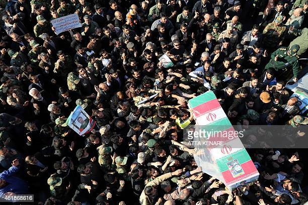 Iranian mourners carry the coffin of Brigadier General Mohammad Ali Allahdadi a commander of the Islamic republic's Revolutionary Guards killed in an...