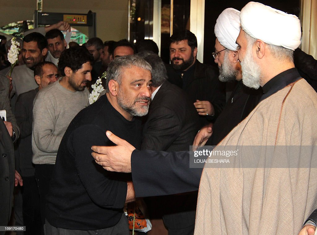 Iranian Muslim Shiite clerics and other officials greet Iranian men who had been held hostage by Syrian rebels since early August as they arrive at a hotel in Damascus after being freed in a prisoner swap on January 9, 2013. A total of 48 Iranians were released in the unprecedented exchange for 2,130 prisoners detained by President Bashar al-Assad's regime, according to several sources.