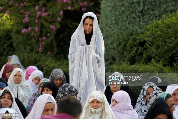TOPSHOT Iranian Muslim women perform Eid alFitr prayers in western Tehran on June 26 2017 Muslims worldwide celebrate Eid alFitr marking the end of...