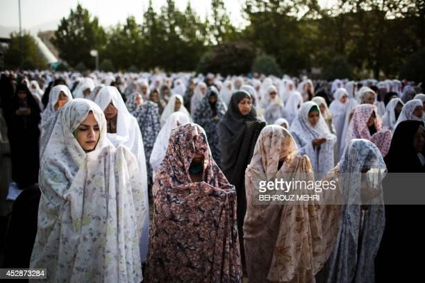 Iranian Muslim women perform their Eid alFitr prayers in western Tehran on July 29 2014 Muslims around the world are celebrating Eid alFitr marking...