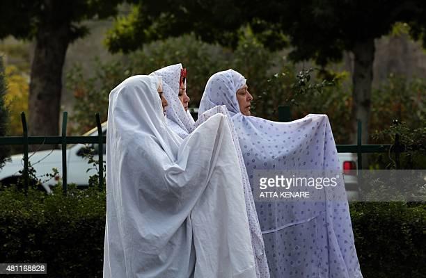 Iranian Muslim women perform their Eid alFitr prayers in western Tehran on July 18 2015 Eid which began on July 17 is the holiday that follows the...