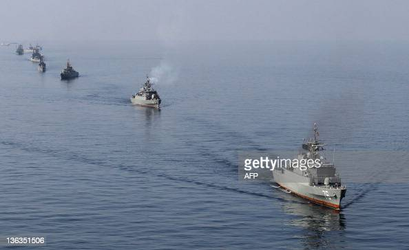 Iranian Navy boats take part in maneuvers during the 'Velayat90' navy exercises in the Strait of Hormuz in southern Iran on January 3 the End day of...