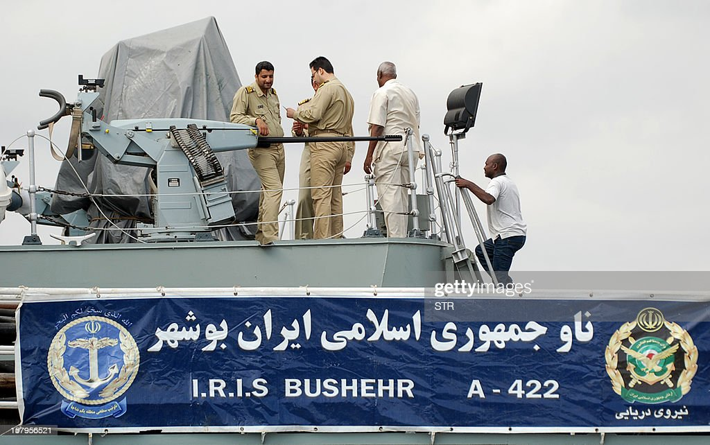 Iranian navy personnel stand aboard the IRIS Bushehr as two Iranian warships docked in the Sudanese Red Sea city of Port Sudan on December 8, 2012. The Iranian navy said the 1,400 ton frigate Jamaran and the 4,700 ton support ship Bushehr 'docked in Port Sudan, after successfully carrying out their assignments in the Red Sea and were greeted by high-ranking Sudanese naval commanders.' Khartoum said it was a 'normal' port call but Israeli officials have expressed concern about arms smuggling through Sudan. AFP PHOTO/STR