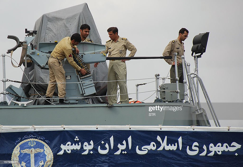 Iranian navy personnel stand aboard the IRIS Bushehr as two Iranian warships docked in the Sudanese Red Sea city of Port Sudan on December 8, 2012. The Iranian navy said the 1,400 ton frigate Jamaran and the 4,700 ton support ship Bushehr 'docked in Port Sudan, after successfully carrying out their assignments in the Red Sea and were greeted by high-ranking Sudanese naval commanders.' Khartoum said it was a 'normal' port call but Israeli officials have expressed concern about arms smuggling through Sudan.