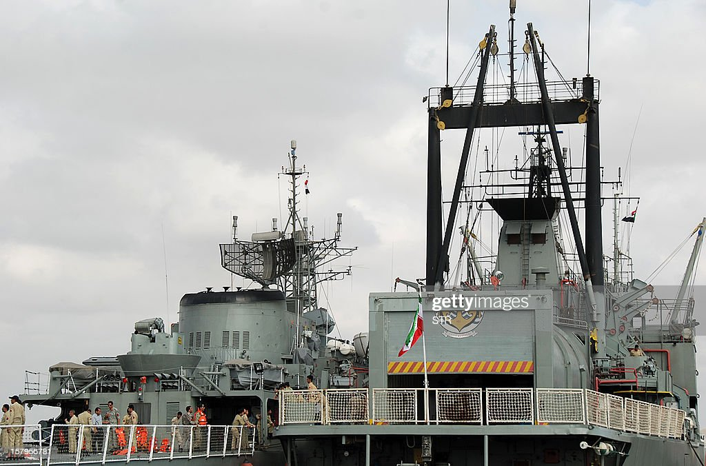Iranian navy personnel stand aboard two Iranian warships docked in the Sudanese Red Sea city of Port Sudan on December 8, 2012. The Iranian navy said the 1,400 ton frigate Jamaran and the 4,700 ton support ship Bushehr 'docked in Port Sudan, after successfully carrying out their assignments in the Red Sea and were greeted by high-ranking Sudanese naval commanders.' Khartoum said it was a 'normal' port call but Israeli officials have expressed concern about arms smuggling through Sudan.