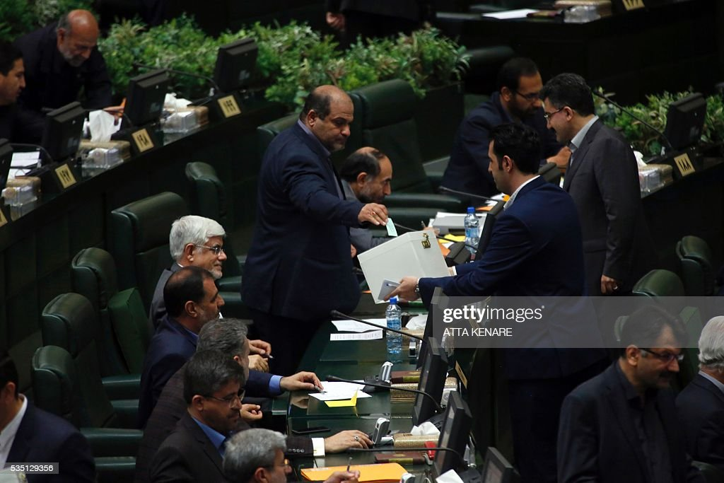 Iranian new lawmakers cast their vote for the new Parliament speaker, during a parliament in Tehran on May 29, 2016. / AFP / ATTA
