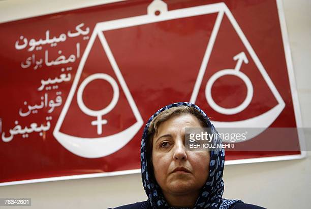 Iranian Nobel peace laureate and women rights activist Shirin Ebadi sits under a banner reading 'one million signatures to change the biased laws'...