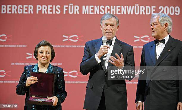 Iranian Nobel peace laureate Shirin Ebadi German President Horst Koehler and prize founder Roland Berger pose during the awards ceremony for the...