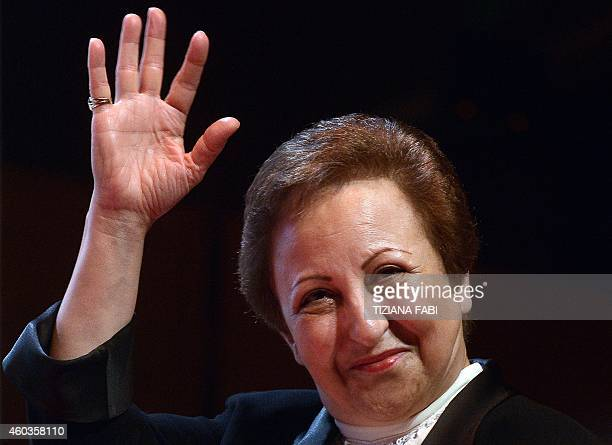 Iranian Nobel Peace laureate Shirin Ebadi waves as she arrives to take part in the 14th World Summit of Nobel Peace Laureates in Rome on December 12...