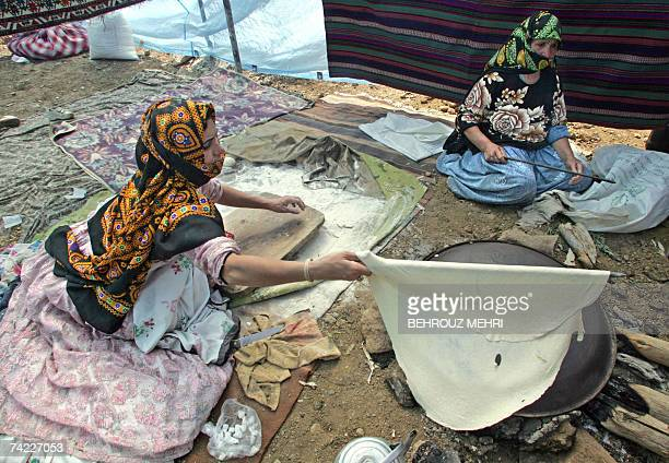 Iranian nomad women cook traditional bread in a tent in Gharah Ghayah village in EastAzarbaijan province northwestern Iran near the border with the...