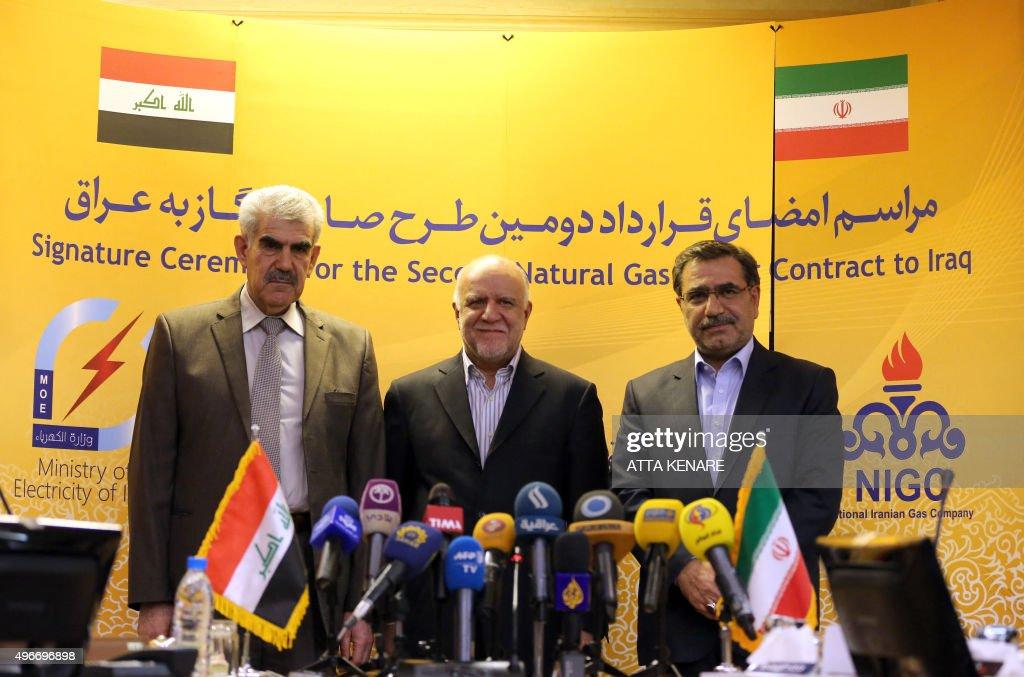 Iranian Oil Minister Bijan Namdar Zanganeh Iraq's Deputy Energy Minister Khaled Hassan Saleh and Iranian Deputy Oil Minister Hamid Reza Araqi pose...